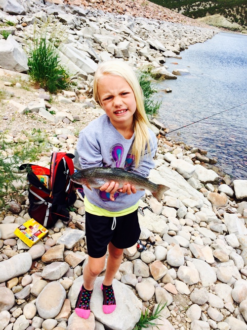 Sandy's Gracie Ladle caught her first fish Saturday at Rockport Reservoir. She is already asking about Strawberry next weekend. She is hooked on the sport. (Courtesy)