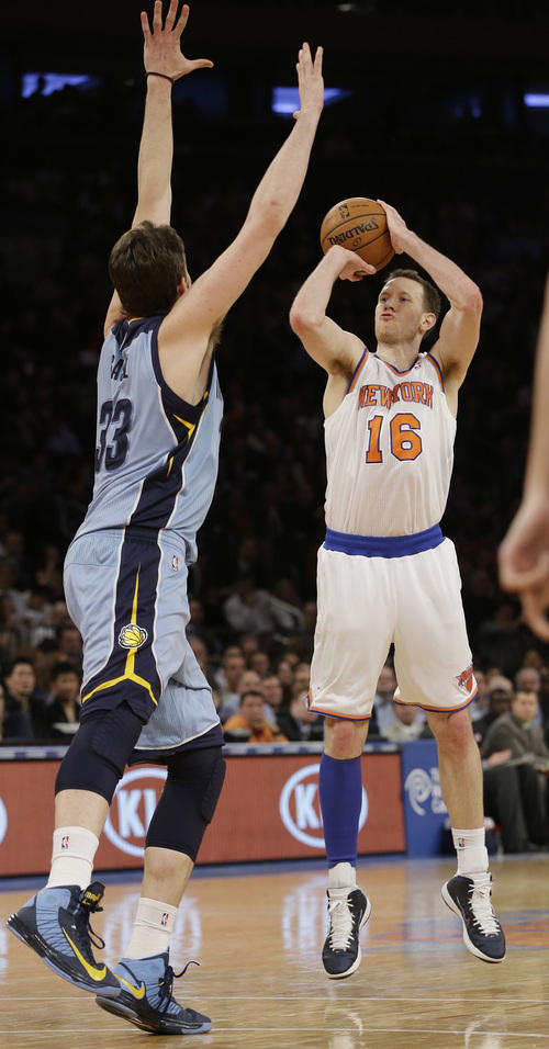 New York Knicks' Steve Novak (16) shoots over Memphis Grizzlies' Marc Gasol (33), of Spain, during the first half of an NBA basketball game on Wednesday, March 27, 2013, in New York. (AP Photo/Frank Franklin II)