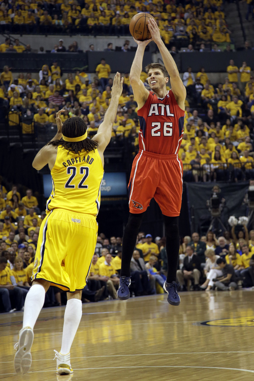Atlanta Hawks guard Kyle Korver (26) shoots over Indiana Pacers forward Chris Copeland (22) during Game 7 of a first-round NBA basketball playoff series in Indianapolis, Saturday, May 3, 2014. (AP Photo/AJ Mast)