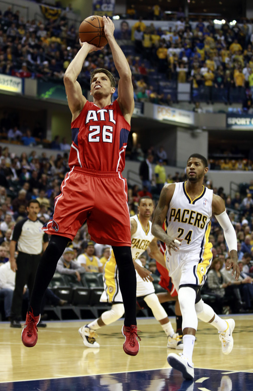 Atlanta Hawks guard Kyle Korver (26) shoots in front of Indiana Pacers forward Paul George during the first half of an NBA basketball game in Indianapolis, Tuesday, Feb. 18, 2014. (AP Photo/R Brent Smith)