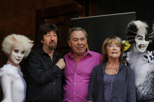 British composer Andrew Lloyd Webber, centre, director Trevor Nunn, centre left, and choreographer Gillian Lynne, centre right, pose for the photographers with performers in cat costumes, during a photo-op to promote the return of the musical Cats, in central London, Monday, July 7, 2014. The show, based on T.S Eliot's 'Old Possum's Book of Practical Cats', will return to the West End for a limited 12-week run from Dec, 2014. Cats, one of the longest-running shows in West End and on Broadway, received its world premiere in London in 1981 where it played for 21 record-breaking years and almost 9,000 performances. According to its creators Cats has been presented in over 26 countries, has been translated into 10 languages and has been seen by over 50 million people world-wide. (AP Photo/Lefteris Pitarakis)