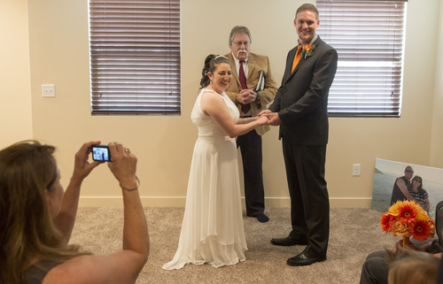 Rick Egan  |  The Salt Lake Tribune Tribune columnist, Robert Kirby performs a wedding for Jerri Lynn Moore  and Zachary Peter Hans at their home in Herriman on Monday, July 7, 2014.