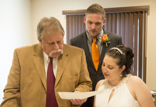 Rick Egan  |  The Salt Lake Tribune Tribune columnist, Robert Kirby performed a wedding for Jerri Lynn Moore  and Zachary Peter Hans at their home in Herriman on Monday, July 7, 2014.