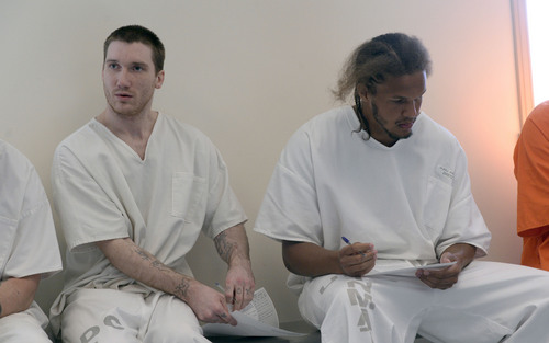 Al Hartmann  |  The Salt Lake Tribune  Prison inmates John Fowers, left,  and Aaron Hukill fill out application at the Utah Prison in Draper Tuesday July 8 to receive temporary state identification documents before being released.  HB 320, passed in 2013 allows eligible individuals to get a temporary state identification document while they gather necessary papers to apply for a permanent ID. The Utah Department of Corrections and Utah Driver License Division have set up a driver license office at the Utah State Prison to provide eligible offenders with a temporary ID document on the day of their release, ensuring they leave prison with the identification they need to rejoin the community. The documents are valid for six months. The program launched July 1.
