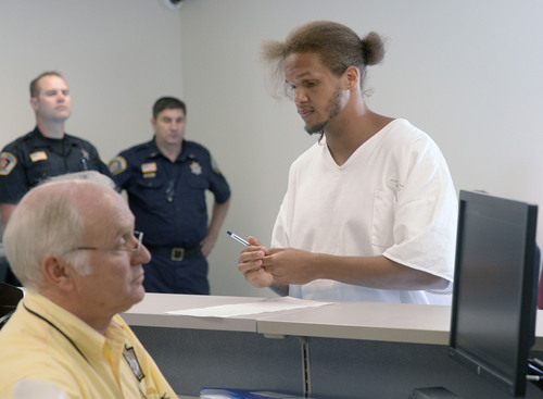 Al Hartmann  |  The Salt Lake Tribune  Prison inmate Aaron Hukill applies at the Utah Driver License Division office set up at Utah Prison in Draper Tuesday July 8 to receive temporary state identification documents before being released.  HB 320, passed in 2013 allows eligible individuals to get a temporary state identification document while they gather necessary papers to apply for a permanent ID. The Utah Department of Corrections and Utah Driver License Division have set up a driver license office at the Utah State Prison to provide eligible offenders with a temporary ID document on the day of their release, ensuring they leave prison with the identification they need to rejoin the community. The documents are valid for six months. The program launched July 1.