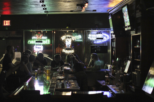 Lennie Mahler  |  The Salt Lake Tribune Bar-goers drink and chat at the north bar in Sugar House Pub.
