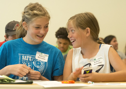Rick Egan  |  The Salt Lake Tribune  Sisters, Adysen and Aubree Hunsaker participate in an activity to learn about personal finances, during a conference by Utah County 4-H Teens Reaching Youth activity at Fidelity in American Fork, Monday, July 7, 2014