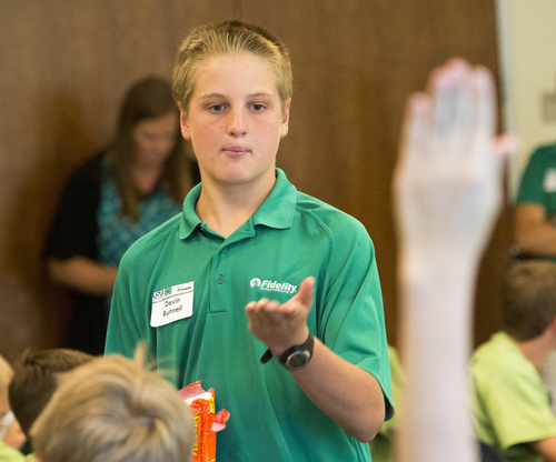 Rick Egan  |  The Salt Lake Tribune  Devin Bunnell leads a discussion, about personal finance, during a conference taught by Utah County 4-H Teens Reaching Youth, at Fidelity investments, in American Fork, Monday, July 7, 2014