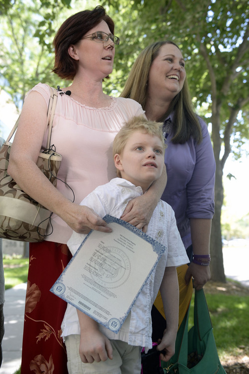 Al Hartmann  |  The Salt Lake Tribune  Annette Maughan, left, holds her hemp extract permit, or cannabis oil permit outside the Utah Dept. of Health Tuesday July 8.  Her son Glenn, 11, has epilepsy and would benefit from the oil. Friend Jennifer May, right.  Maughan and May are co-founders of Hope for Children with Epilepsy.  The new state law allows to import the supplement from a company in Colorado called Realm of Caring. To get the permit the patient needs to prove they have intractable epilepsy -- or epilepsy that is resistant to at least three or more treatments.