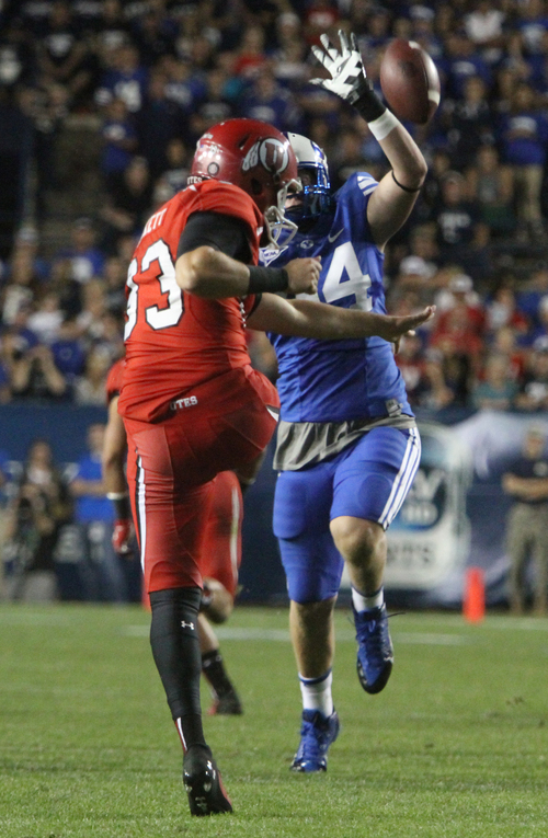 Rick Egan  | The Salt Lake Tribune   Brigham Young Cougars defensive lineman Remington Peck (44) nearly bucks a punt by Utah Utes punter Tom Hackett, as BYU faced The University of Utah, at Lavell Edwards Stadium, Saturday, September 21, 2013.