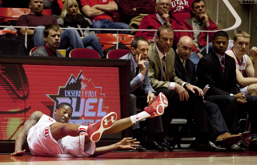 JIM MCAULEY | The Salt Lake Tribune Utah's Delon Wright falls while chasing a loose ball during a game against the St. Katherine Firebirds at the University of Utah's Huntsman Center on December 28, 2013.