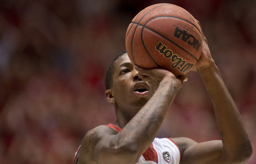 Lennie Mahler  |  The Salt Lake Tribune Utah's Delon Wright shoots a free throw in the second half as the Utes led Colorado at the Huntsman Center, Saturday, March 1, 2014.