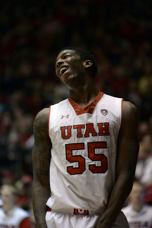 Francisco Kjolseth  |  The Salt Lake Tribune Utah Utes guard Delon Wright (55) laughs as he misses a shot in game action against Washington at the Huntsman Center on the University of Utah campus on Thursday, Feb. 6, 2014.