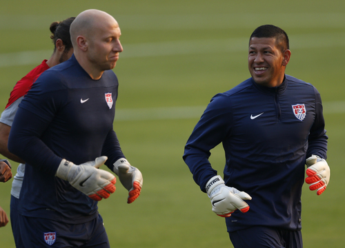 United States goalkeepers Brad Guzan, left, and Nick Rimando talk while jogging during a training session in Sao Paulo, Brazil, Tuesday, June 17, 2014.  The United States will play against Portugal in group G of the 2014 soccer World Cup on June 22. (AP Photo/Julio Cortez)