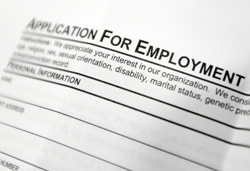 FILE - This April 22, 2014, file photo shows an employment application form on a table during a job fair at Columbia-Greene Community College in Hudson, N.Y.  The Labor Department reports the number of people who applied for unemployment benefits last week on Thursday, July 10, 2014. (AP Photo/Mike Groll, File)