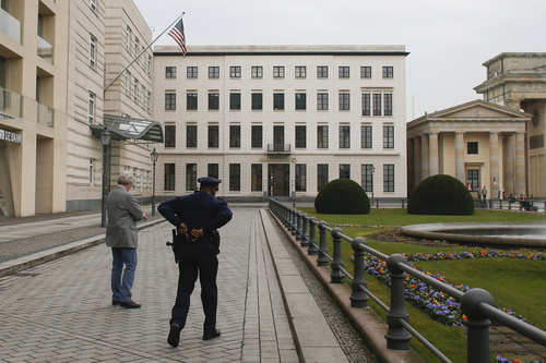 """FILE -  In this April 16, 2013 file photo United States security officers patrol in front of the  U.S. embassy in Berlin, Germany. Germany took the dramatic step Thursday of asking the top U.S. intelligence official in Berlin to leave the country, following two reported cases of suspected U.S. spying and the yearlong spat over eavesdropping by the National Security Agency. """"The representative of the U.S. intelligence services at the United States embassy has been asked to leave Germany,"""" government spokesman Steffen Seibert said in a statement, Thursday, July 10,2014. (AP Photo/Markus Schreiber, File)"""
