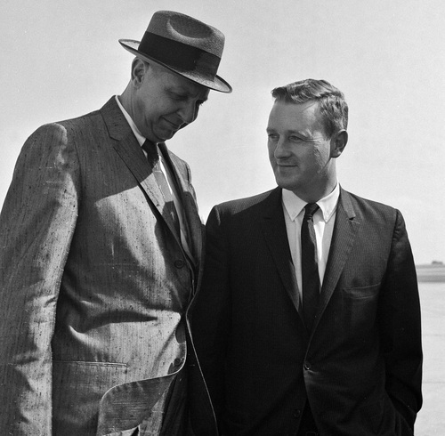 FILE - In this May 21, 1961 file photo, John Seigenthaler, right, the Kennedy administration's chief negotiator with the governor of Alabama during the 1961 Freedom Rides, talks with Charles Meriwether as they leave Montgomery, Ala. A day earlier, he was attacked and knocked unconscious by a mob of Klansmen in Montgomery, Ala., as tried to aid a young protester who was being pursued by the rioters. Meriwether, a former Alabama official who became a director of the Export-Import Bank of the United States, was visiting. Seigenthaler, the journalist who edited The Tennessean newspaper, helped shape USA Today and worked for civil rights during the Kennedy administration, died Friday, July 11, 2014. He was 86. (AP Photo)