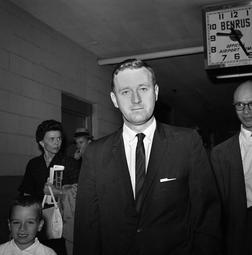 FILE - In this May 21, 1961 file photo, John Seigenthaler, the Kennedy administration's chief negotiator with the governor of Alabama during the 1961 Freedom Rides, walks through the airport in Montgemery, Ala. A day earlier, he was attacked and knocked unconscious by a mob of Klansmen in Montgomery, Ala., as tried to aid a young protester who was being pursued by the rioters. Seigenthaler, the journalist who edited The Tennessean newspaper, helped shape USA Today and worked for civil rights during the Kennedy administration, died Friday, July 11, 2014. He was 86. (AP Photo)