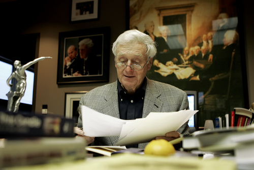 FILE - In this Monday, Dec. 5, 2005 file photo, John Seigenthaler works in his office in Nashville, Tenn. Seigenthaler, the journalist who edited The Tennessean newspaper, helped shape USA Today and worked for civil rights during the Kennedy administration, died Friday, July 11, 2014. He was 86. (AP Photo/Mark Humphrey)