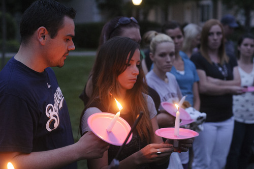 Eli Lucero | Herald Journal  Friends of the Haskell family gather near the home the family used to live in, in Logan, for a candlelight vigil on Thursday night.