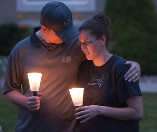 Eli Lucero | Herald Journal  Steve and Cyndi Ford, who were friends of the Haskell family gather in Logan, for a candlelight vigil on Thursday night.