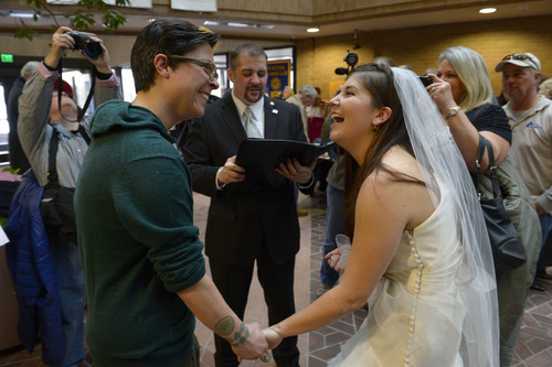 Francisco Kjolseth  |  Tribune file photo Jax Collins, left, and Heather Collins are overjoyed as they are married by Rev. Christopher Scuderi of Universal Heart Ministry on Monday, Dec. 23, 2013, at the Salt Lake City County offices.