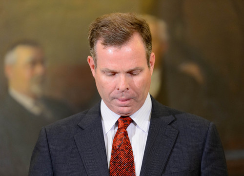 Trent Nelson  |  Tribune file photo Utah Attorney General John Swallow announces his resignation Thursday, Nov. 21, 2013, in Salt Lake City. FBI and state law enforcement agents searched Swallow's residence in Sandy on Monday.