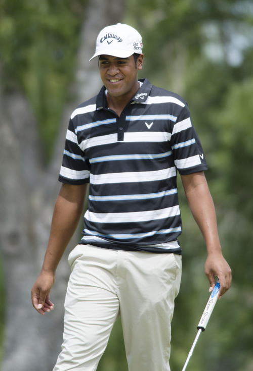 Steve Griffin  |  The Salt Lake Tribune   Lehi resident Tony Finau smiles as he just misses a birdie putt  during first round play in the Web.Com golf tour event at Willow Creek Country Club  in Sandy, Utah Thursday, July 10, 2014.