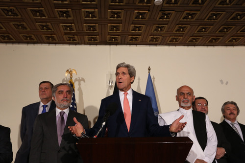 "U.S. Secretary of State John Kerry, center, Afghan presidential candidate Abdullah Abdullah, left, and Afghanistan's presidential candidate Ashraf Ghani Ahmadzai, right, speaks during a joint press conference in Kabul, Afghanistan, Saturday, July 12, 2014. U.S. Secretary of State John Kerry says both of Afghanistan's presidential candidates are committed to abiding by the results of the ""largest, most comprehensive audit"" of the election runoff ballots possible. (AP Photo/Rahmat Gul)"