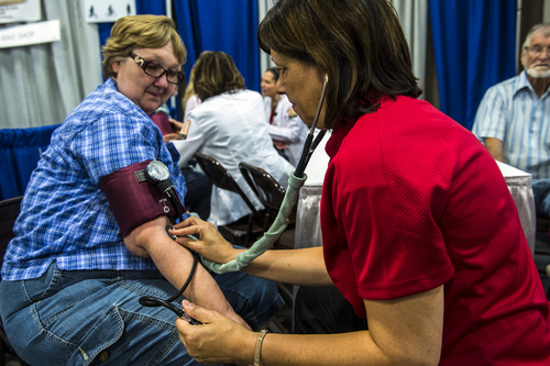 Chris Detrick  |  The Salt Lake Tribune Colleen Johnson, of West Valley City, has her blood pressure checked by Southern Utah University Nursing Professor Shelley Sanderson during the KUTV 2 Your Health Expo at the South Towne Exposition Center on Saturday.
