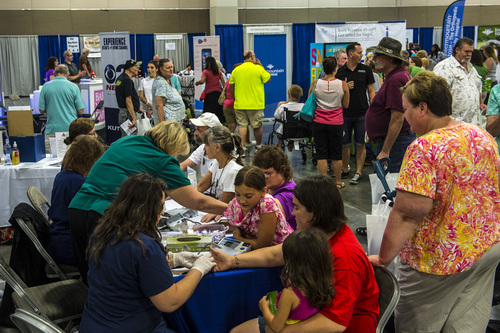 Chris Detrick  |  The Salt Lake Tribune People have their blood sugar and blood pressure checked during the KUTV 2 Your Health Expo at the South Towne Exposition Center Saturday July 12, 2014.