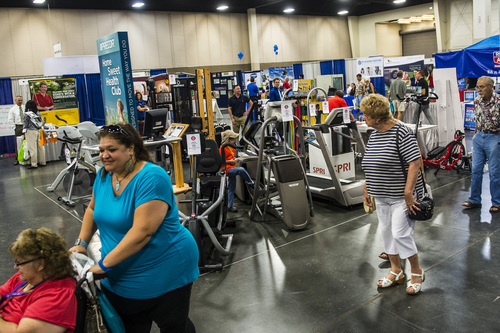 Chris Detrick  |  The Salt Lake Tribune People walk around during the KUTV 2 Your Health Expo at the South Towne Exposition Center Saturday July 12, 2014.