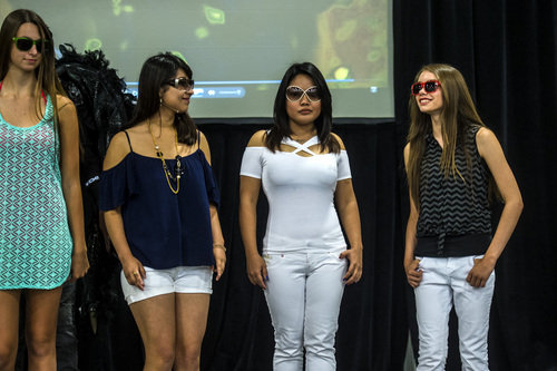 Chris Detrick  |  The Salt Lake Tribune Models show off different sunglasses during the Standard Optical eyewear fashion show during the KUTV 2 Your Health Expo at the South Towne Exposition Center Saturday July 12, 2014.