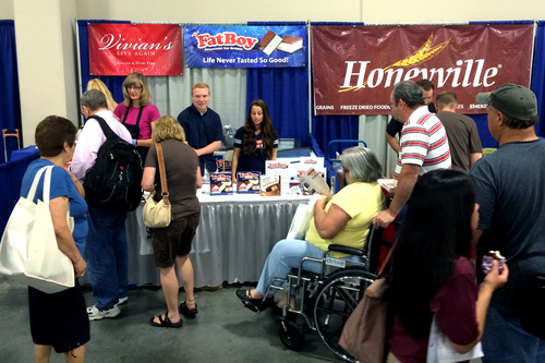 Chris Detrick  |  The Salt Lake Tribune People line up to receive free Fat Boy ice cream sandwiches during the KUTV 2 Your Health Expo at the South Towne Exposition Center Saturday July 12, 2014.
