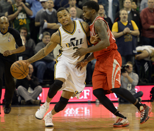 Rick Egan  | The Salt Lake Tribune    Houston Rockets point guard Aaron Brooks (0) guards Utah Jazz point guard Trey Burke (3) in NBA action, Utah Jazz vs. the Houston Rockets, at the EnergySolutions Arena, Monday, December 2, 2013.