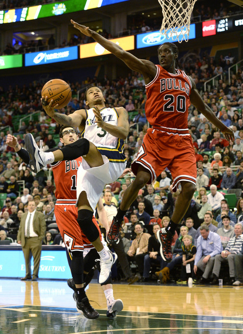 Rick Egan  | The Salt Lake Tribune   Utah Jazz point guard Trey Burke (3) goes in for a lay up, as Chicago Bulls small forward Tony Snell (20) defends, in NBA action, as theJazz faced the Chicago Bulls, at the EnergySolutions Arena, Monday, November 25, 2013.