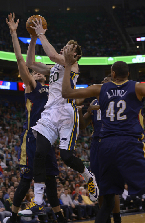 Leah Hogsten  |  The Salt Lake Tribune Utah Jazz guard Gordon Hayward (20) drives to the net. The Utah Jazz defeated the New Orleans Pelicans 100-96 during their game Friday, April 4, 2014 at Energy Solutions Arena.