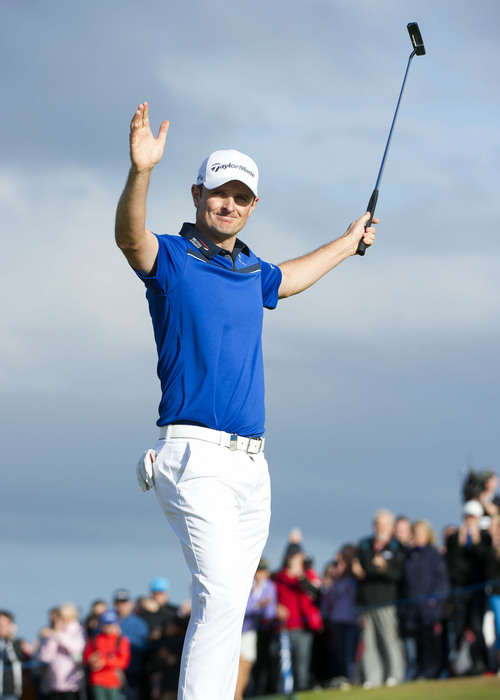 Justin Rose celebrates holing the winning putt to give him the title during day four of the Scottish Open at Royal Aberdeen, Aberdeen, Scotland, Sunday July 13, 2014. (AP Photo/PA, Kenny Smith)  UNITED KINGDOM OUT  NO SALES  NO ARCHIVE