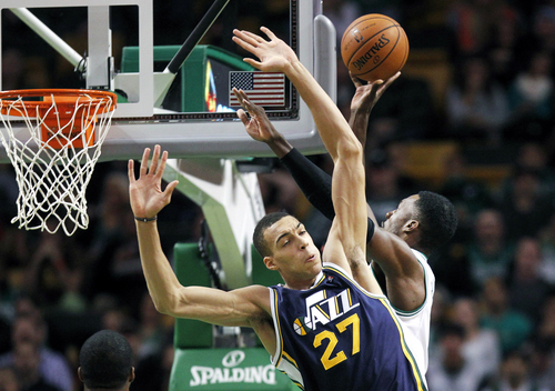 Utah Jazz center Rudy Gobert (27) is cleared out by Boston Celtics power forward Jeff Green, right, as he shoots during the first quarter of an NBA basketball game in Boston, Wednesday, Nov. 6, 2013. (AP Photo/Elise Amendola)