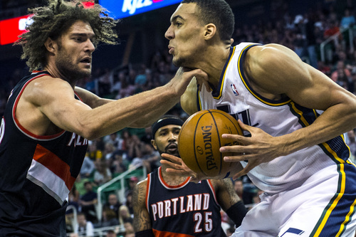 Chris Detrick     The Salt Lake Tribune Portland Trail Blazers center Robin Lopez (42) hits Utah Jazz center Rudy Gobert (27) in the neck during the game at EnergySolutions Arena Friday April 11, 2014. Portland is winning the game 53-51 at halftime.