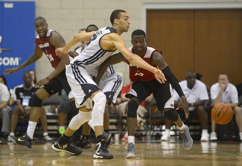 Utah Jazz center Rudy Gobert slaps the ball away from Miami Heat guard Myck Kabongo, right, during the second half of an NBA Orlando Pro Summer League game in Orlando, Fla., Sunday, July 7, 2013. (Special to the Tribune/Phelan M. Ebenhack)