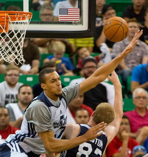 Trent Nelson     The Salt Lake Tribune Rudy Gobert defending Brock Motum as the Utah Jazz hold an open practice in Salt Lake City, Thursday July 10, 2014.