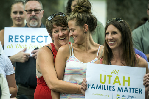 "Chris Detrick  |  The Salt Lake Tribune Autumn Hickman and her girlfriend Becca Schwartz, embrace outside of the Governor's Mansion in Salt Lake City Wednesday July 9, 2014. Utah Unites for Marriage delivered more than 3,800 signatures collected on a petition urging Governor Gary Herbert and Attorney General Sean Reyes to end their ""relentless court fight to stop same-sex marriage and deny legally married couples recognition and access to second-parent adoptions."""
