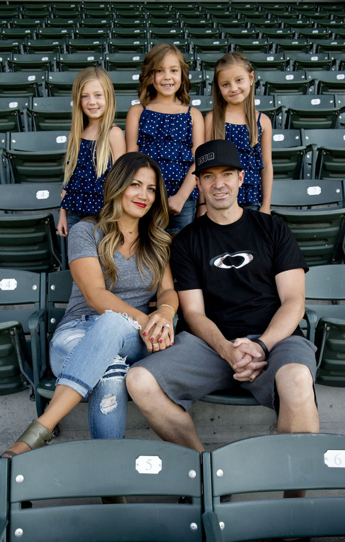 Jeremy Harmon  |  The Salt Lake Tribune  Zach Sorenson and his wife Shally Sorensen pose for a family picture along with their daughters at Smith's Ballpark in Salt Lake City on Saturday, July 5, 2014. The girls are (l-r) Cambry, 7, and twins Braylen and Serae, 8.