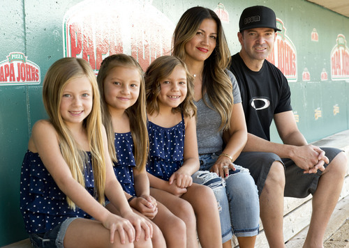 Jeremy Harmon  |  The Salt Lake Tribune  Zach Sorenson and his wife Shally Sorenson pose for a family picture along with their daughters at Smith's Ballpark in Salt Lake City on Saturday, July 5, 2014. The girls are (l-r) Cambry, 7, and twins Serae and Braylen, 8.
