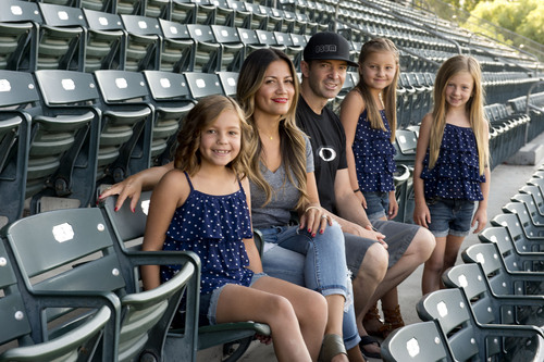 Jeremy Harmon  |  The Salt Lake Tribune  Zach Sorenson and his wife Shally Sorensen pose for a family picture along with their daughters at Smith's Ballpark in Salt Lake City on Saturday, July 5, 2014. The girls are (l-r) twins Braylen and Serae, 8, and Cambry 7.