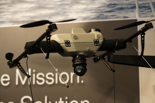 An AeroVironment Shrike vertical take-off and landing small unmanned aircraft system is displayed at the AeroVironment stand during Farnborough International Air Show, Farnborough, England, Tuesday, July 15, 2014. (AP Photo/Sang Tan)