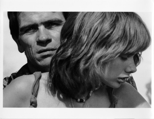 """Tommy Lee Jones and Rosanna Arquette in a scene from the 1982 TV movie """"The Executioner's Song"""" about killer Gary Gilmore, which was filmed in Utah. Courtesy Polaris Communications, Inc. All Rights Reserved. Photo © Alex Webb"""