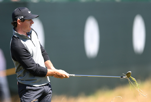 Rory McIlroy of Northern Ireland plays a shot onto the 5th green during a practice round ahead of the British Open Golf championship at the Royal Liverpool golf club, Hoylake, England, Tuesday July 15, 2014. The British Open starts on Thursday July 17. (AP Photo/Scott Heppell)