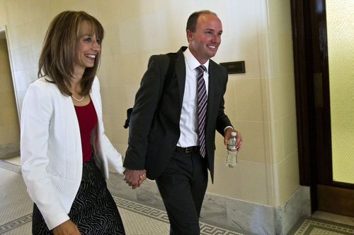 Chris Detrick  |  The Salt Lake Tribune Rep. Spencer Cox and his wife Abby walk away after the confirmation hearing for Lieutenant Governor nominee Rep. Spencer Cox at the Utah State Capitol Tuesday October 15, 2013.